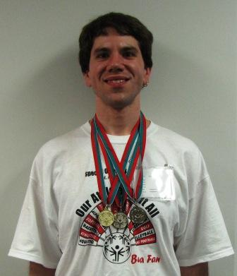 Jim Downs displaying his medals
