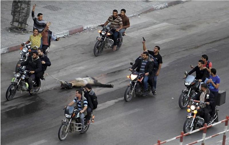 Palestinian militants in Gaza dragging body of a man accused spying for Israel