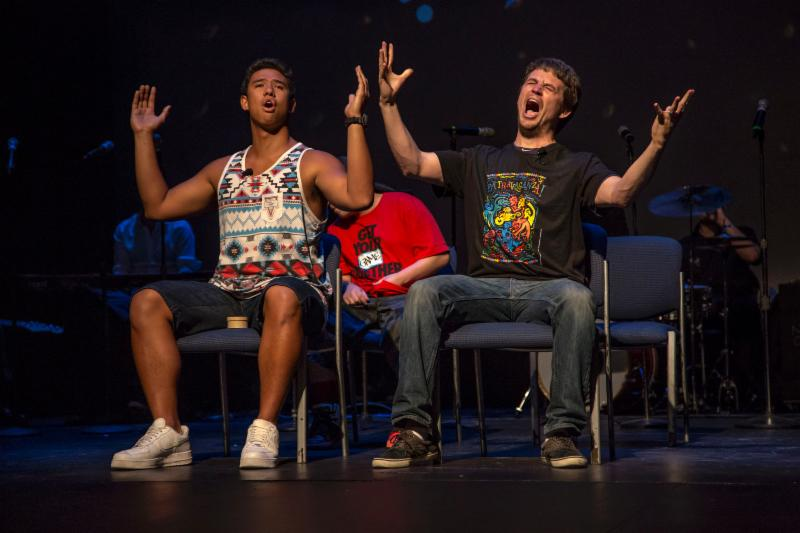 A student and a staff member belt out a song from Frozen at Extravaganza 2014