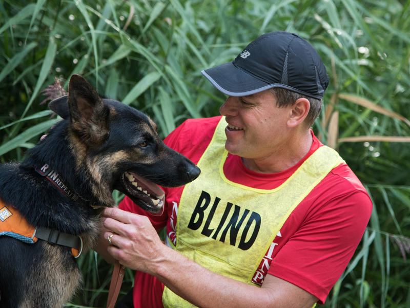 United in Stride founder Richard Hunter poses with Klinger_ the first ever running guide dog _Photo_ Mark Liflander_