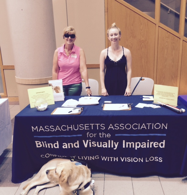 Volunteer Coordinator Jen Buchanan and Program Assistant Shannon May _along with Jen_s guide dog Keating__ at a recent Volunteer Fair at the Massachusetts School of Pharmacy