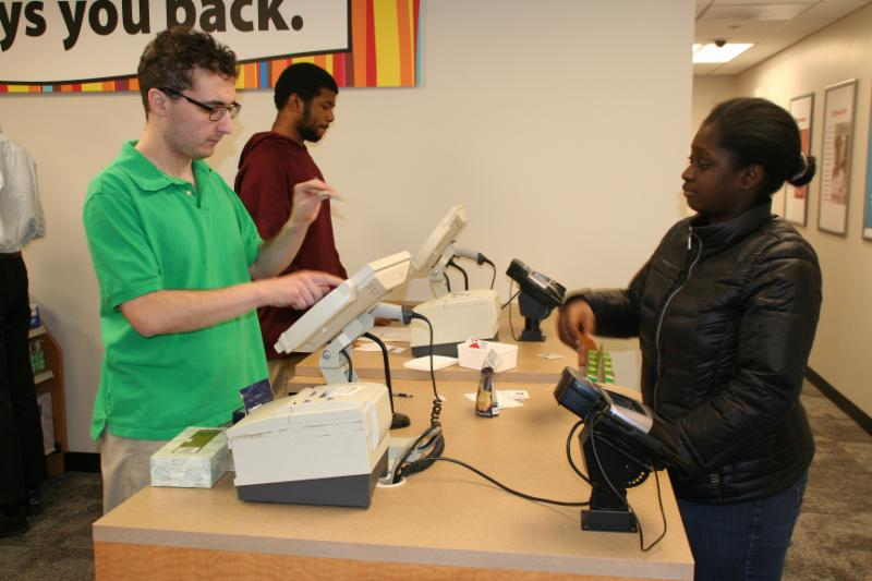 An Ivy Street student rings out a customer at the Transitions to Work mock CVS