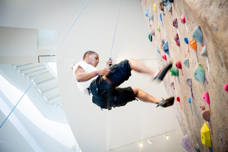 A student rock climbing at BU FitRec