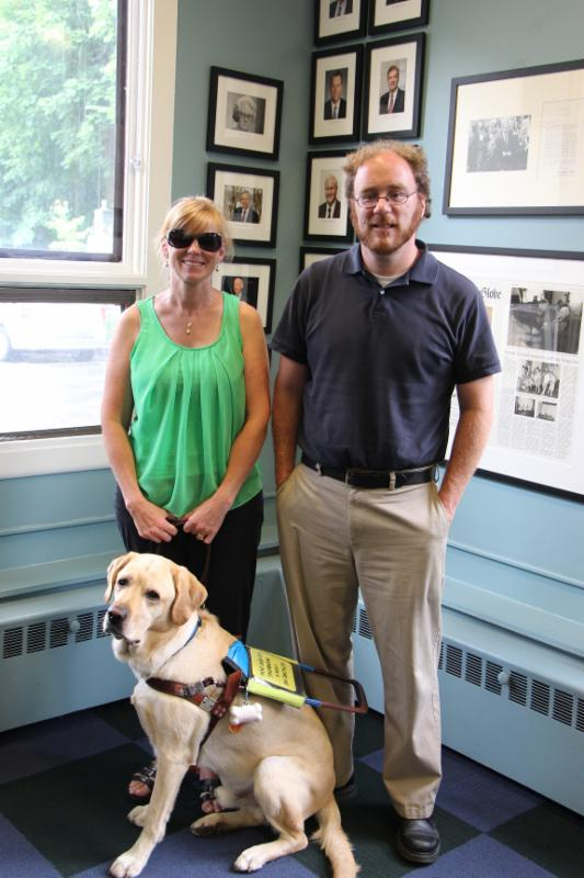 Kyle Robidoux, Jen Buchanan, and Jen's dog Keating pose in MABVI's Brookline offices