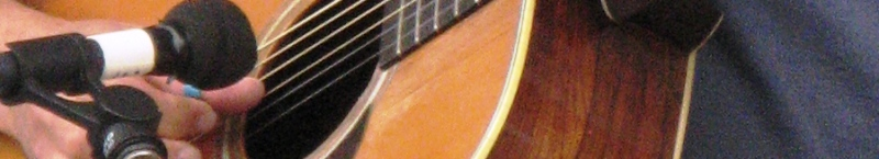 close up of guitar sound hole & mic