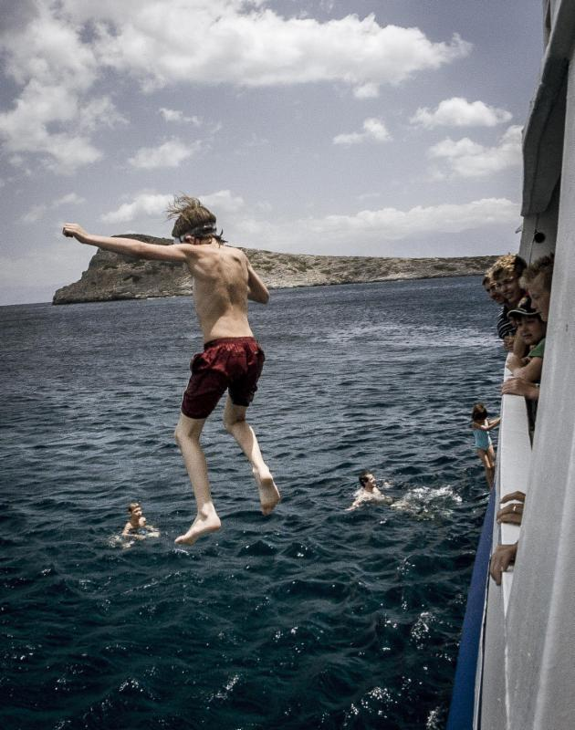 Kid jumping from boat