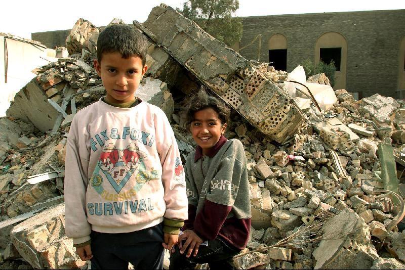 Kids near rubble in Iraq