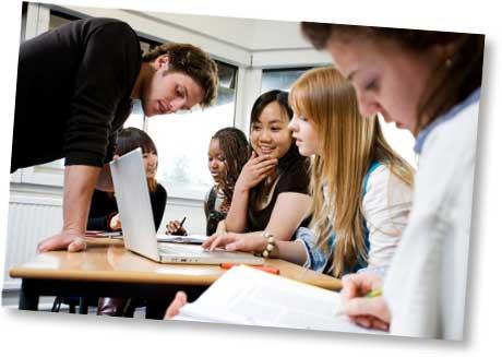 Teen students on laptop