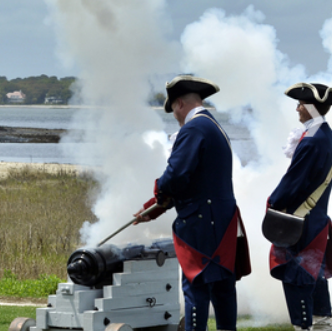 Why do they fire a canon shot at the Heritage Golf Tournament?