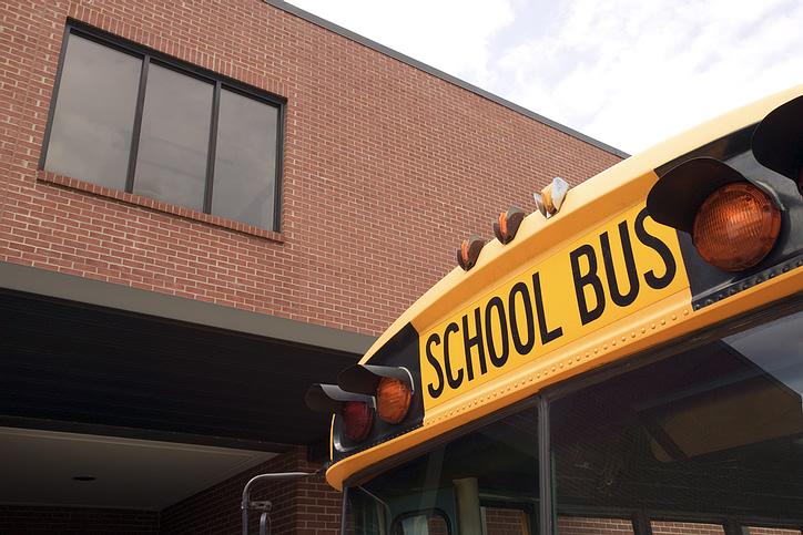 school bus in front of school building