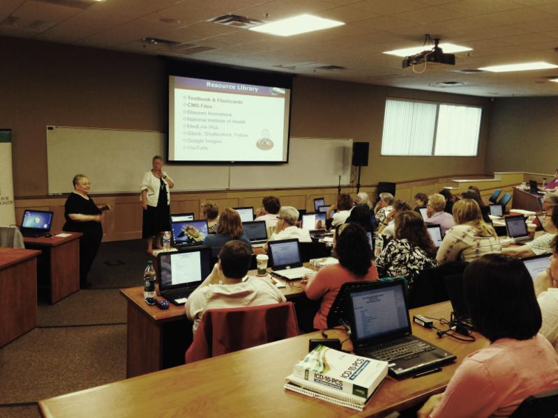 ICD-10 Faculty lead a training session for coding students at Southern New Hampshire University.