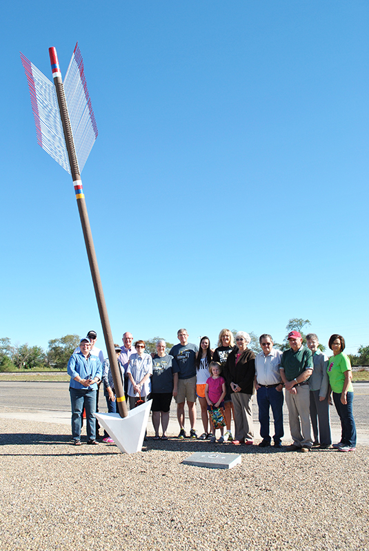 Hall County friends surround the Quanah Parker Trail giant arrow in Memphis