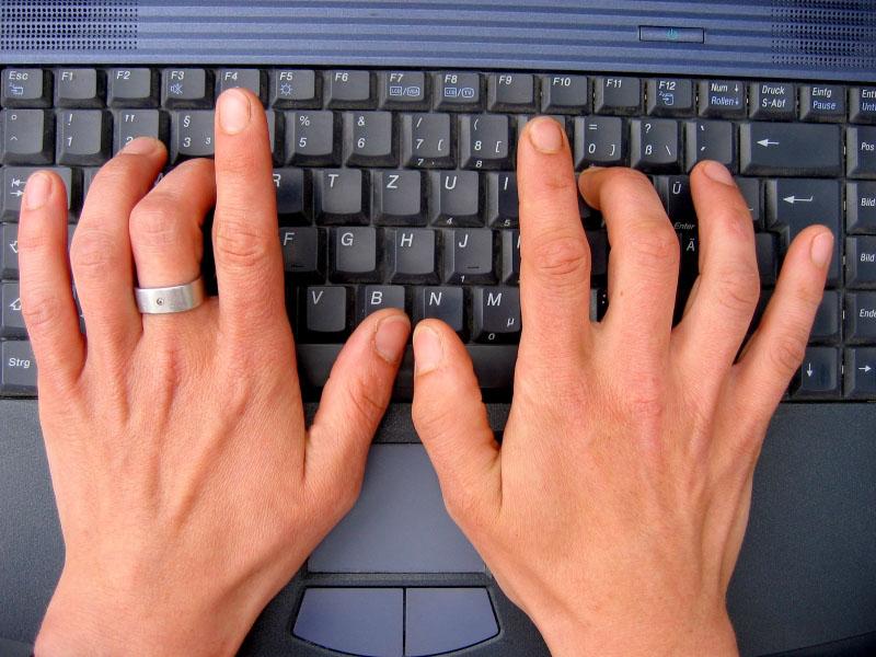 female hands on keyboard
