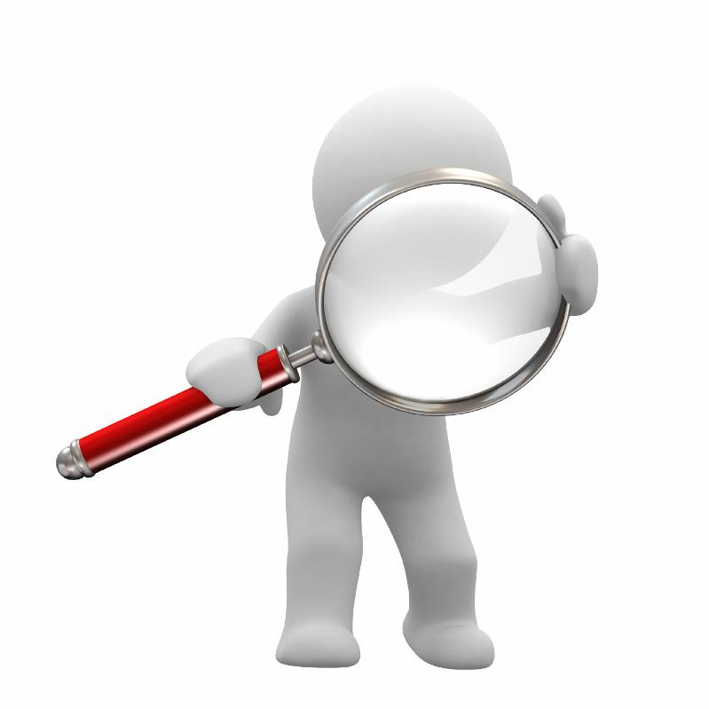 man looking into magnifying glass