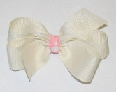 Cream bow with pink center
