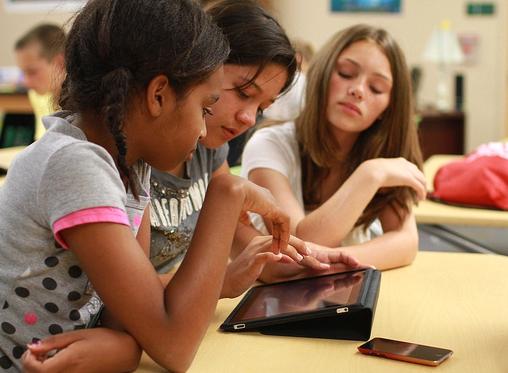 kids with ipad (NASA image)