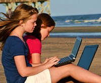 Teen Geniuses Work on Laptops