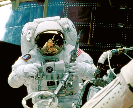 Astronaut Steve Smith Fixes the Hubble Satellite (Image by NASA)