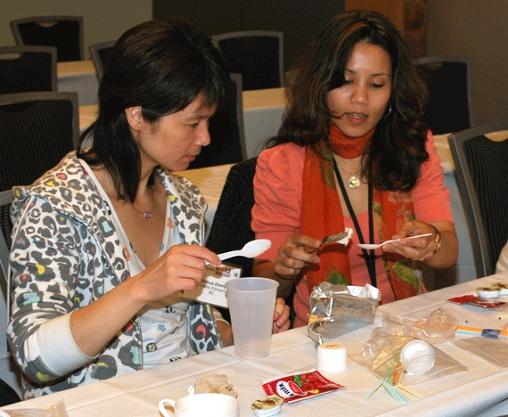 Two teachers make lip gloss in a SWE Teacher Workshop