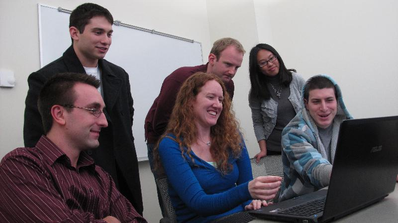 Kathleen Deloughery chats with students before class
