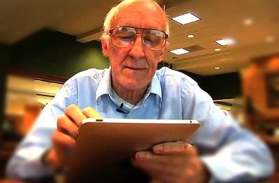 older man with computer tablet