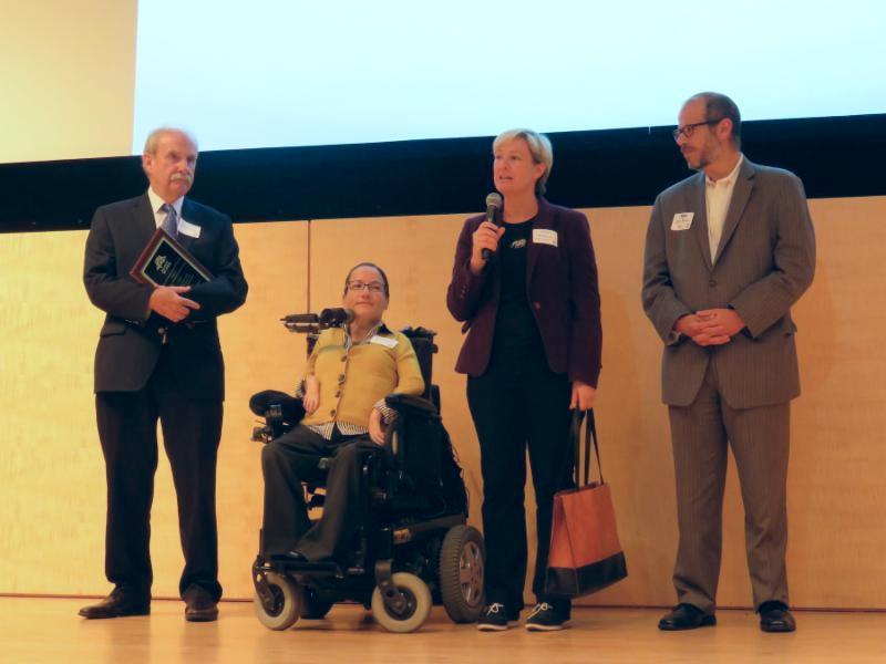 4 people receiving an award for Free Muni