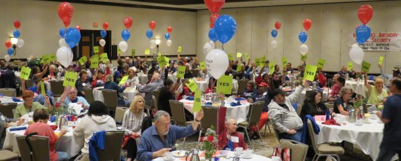 picture of seniors at the CARA Convention holding up Yes signs