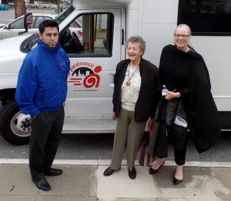 event sponsors in front of paratransit van