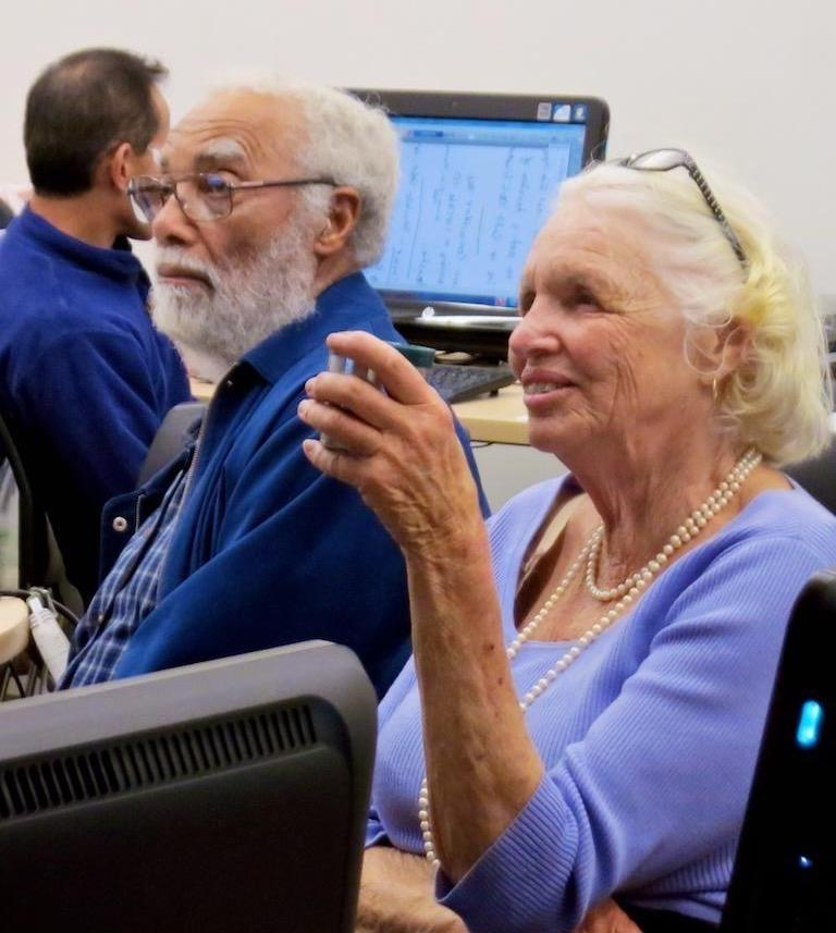 seniors smiling in computer class