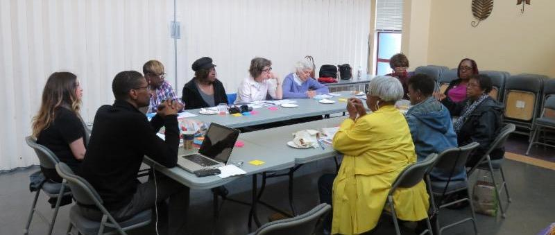 group around the table as the focus group