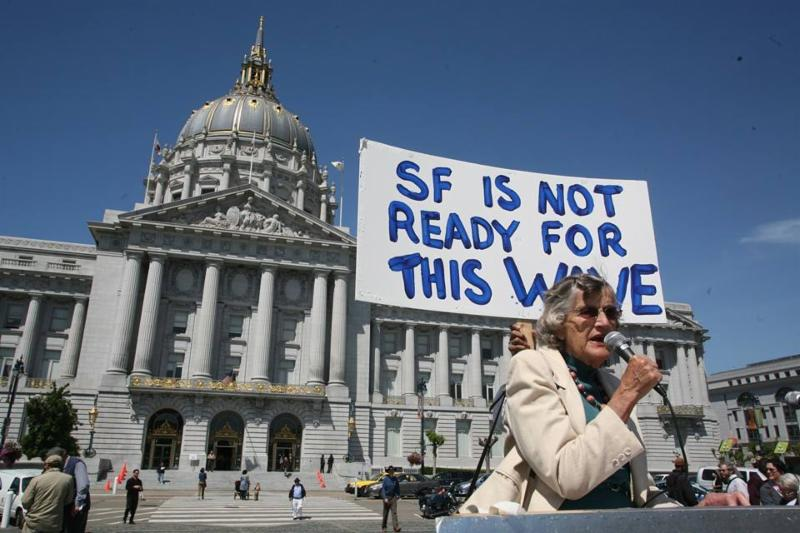 women in front of sign reading SF is not ready for this wave