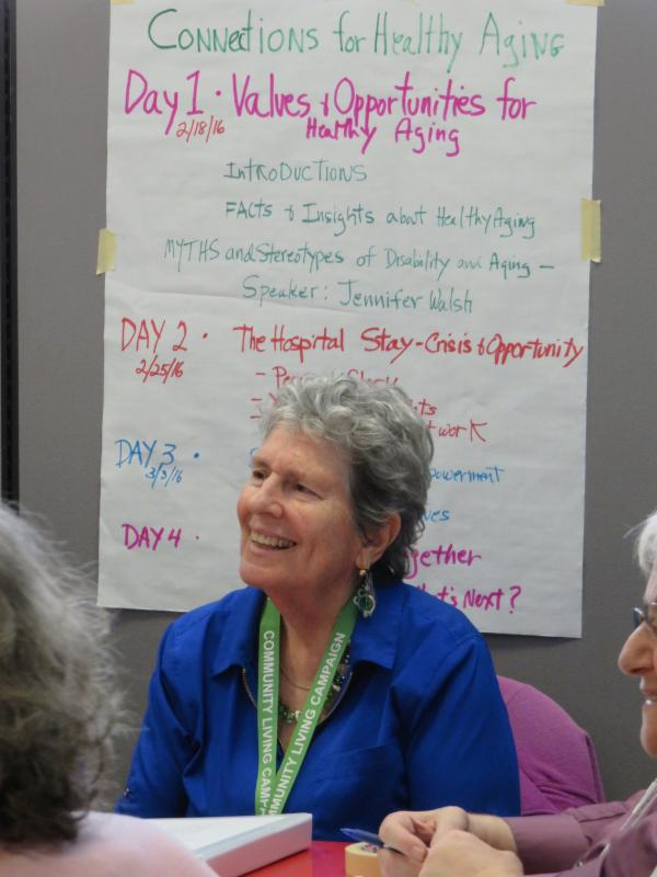 workshop leader with agenda on the wall behind