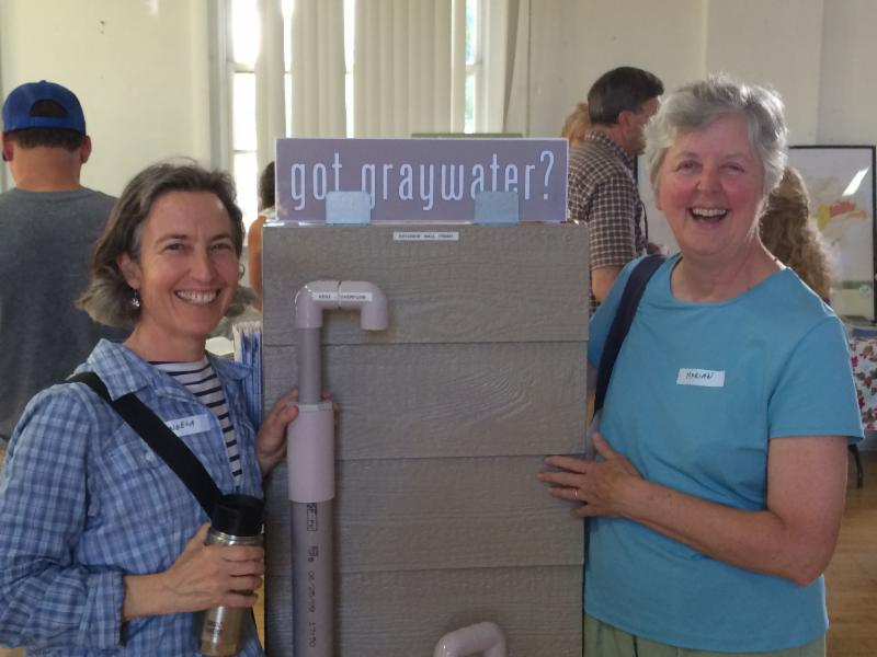 Angela Ocone with sister-in-law Marian pose with graywater demo model