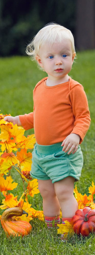 Toddler with leaves