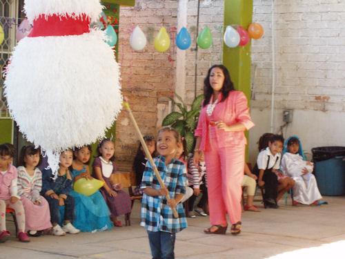 KinderAide Experience hitting the pinata