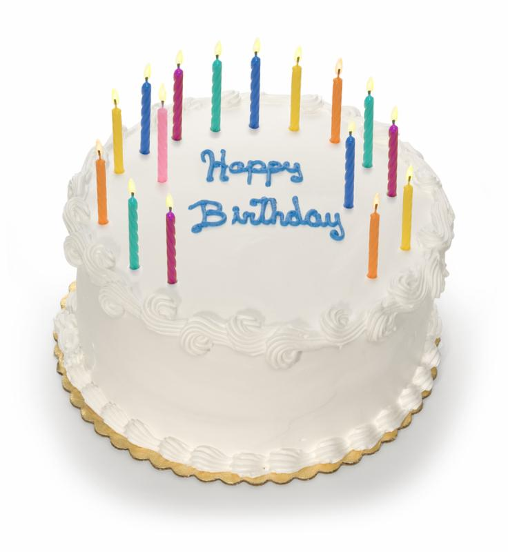a white birthday cake isolated on a white background with candles