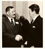 Admiral Carey shaking hands with former President Ronald Reagan
