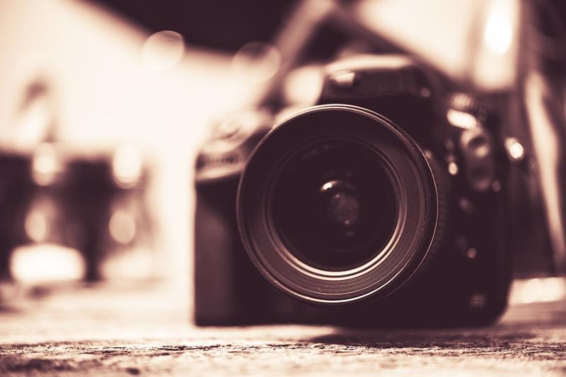 Digital Camera with Wide Angle Lens Vintage Browny Color Grading.