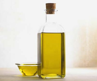 Olive oil in bottle and smalll bowl