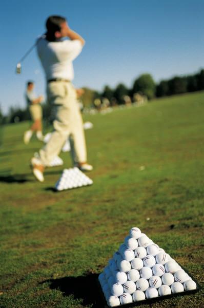 Players hitting balls on range