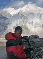 Michael Brown with IMAX camera,Everest in the background