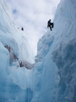 James balog of Extreme Ice rappels into crevasse