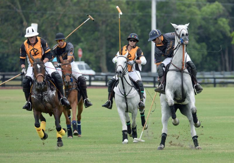 Guille Aguero (3) of Polo Gear tries to outrace defenders Carlitos Gracida