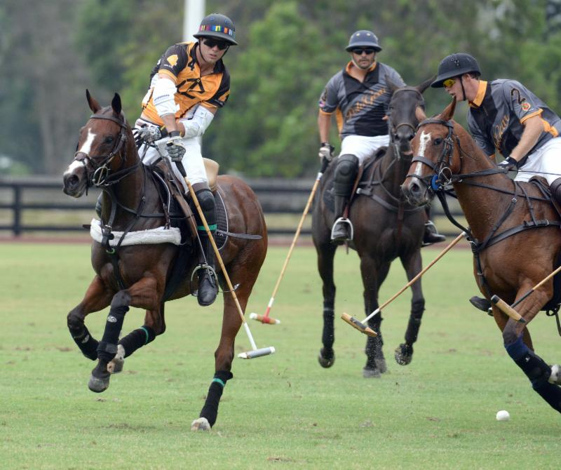 Polo Gear's Alejandro Gonzales (2) and Guille Aguero (3) defend Carlitos Gr