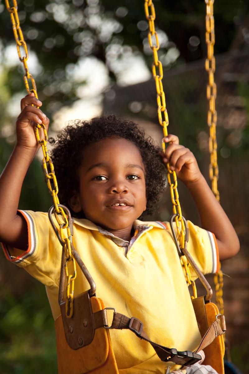 young aa boy on swing
