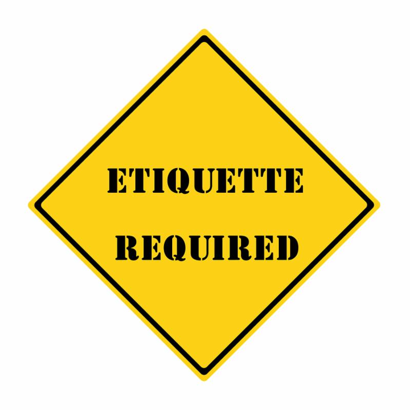 A yellow and black diamond shaped road sign with the words ETIQUETTE REQUIRED making a great concept.