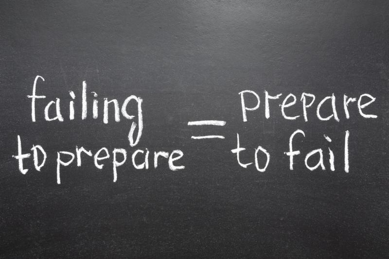 interpretation of famous quote of B. Franklin  By failing to prepare you are preparing to fail.  handwritten on blackboard