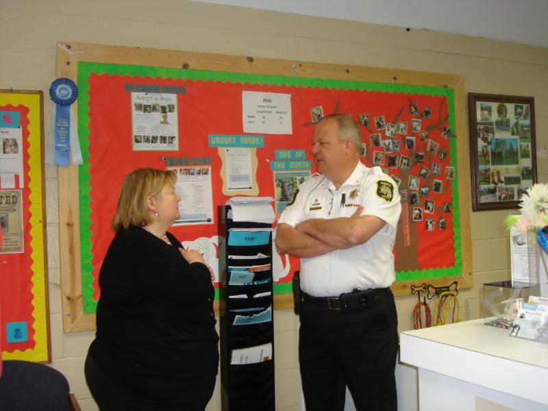Monroe 2014 Shelter Award 4-29-16 radio station lady, Sheriff Dale Malone