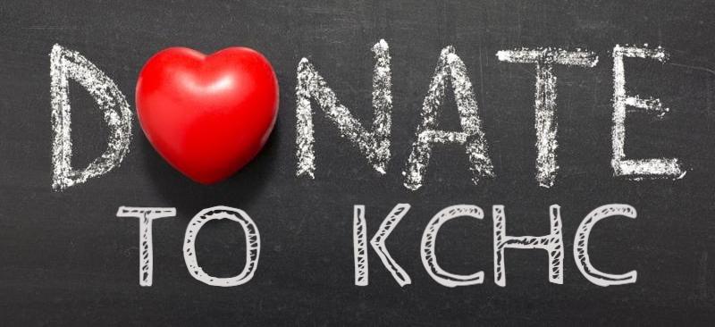 donate word hand written on school blackboard