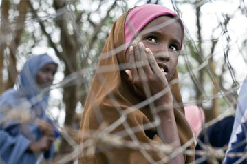 A refugee child looks out from an overcrowded camp in Dadaab.